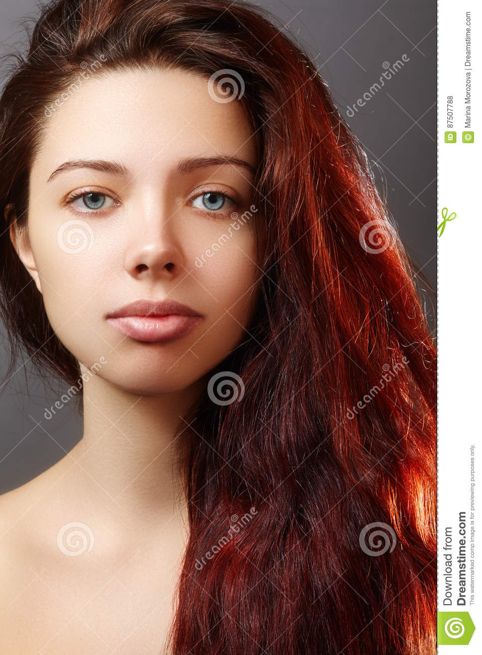 Beautiful ginger young woman with luxury hair style and fashion gloss makeup. Beauty closeup model
