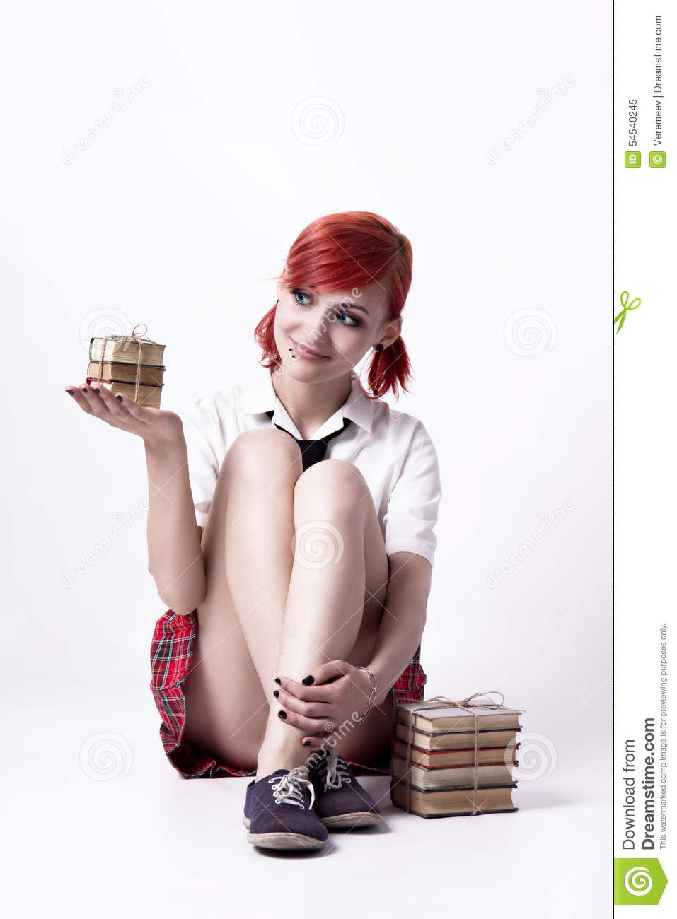 Beautiful girl in anime style with stacks of books