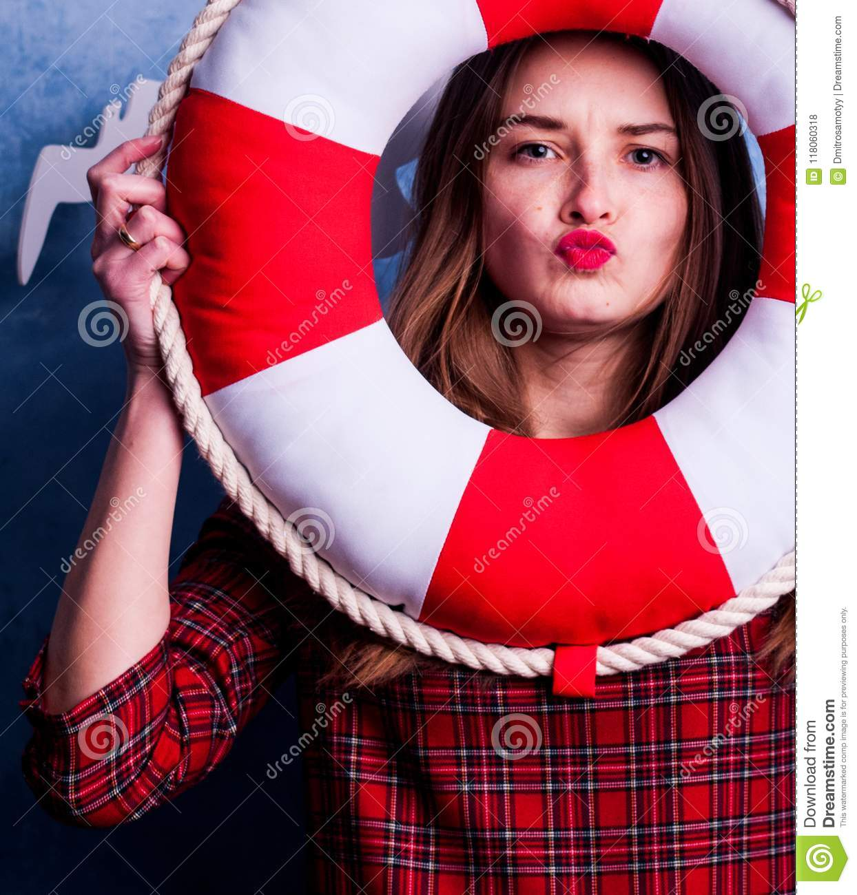 Beautiful girl on a blue background with a tangy red circle. Marine design