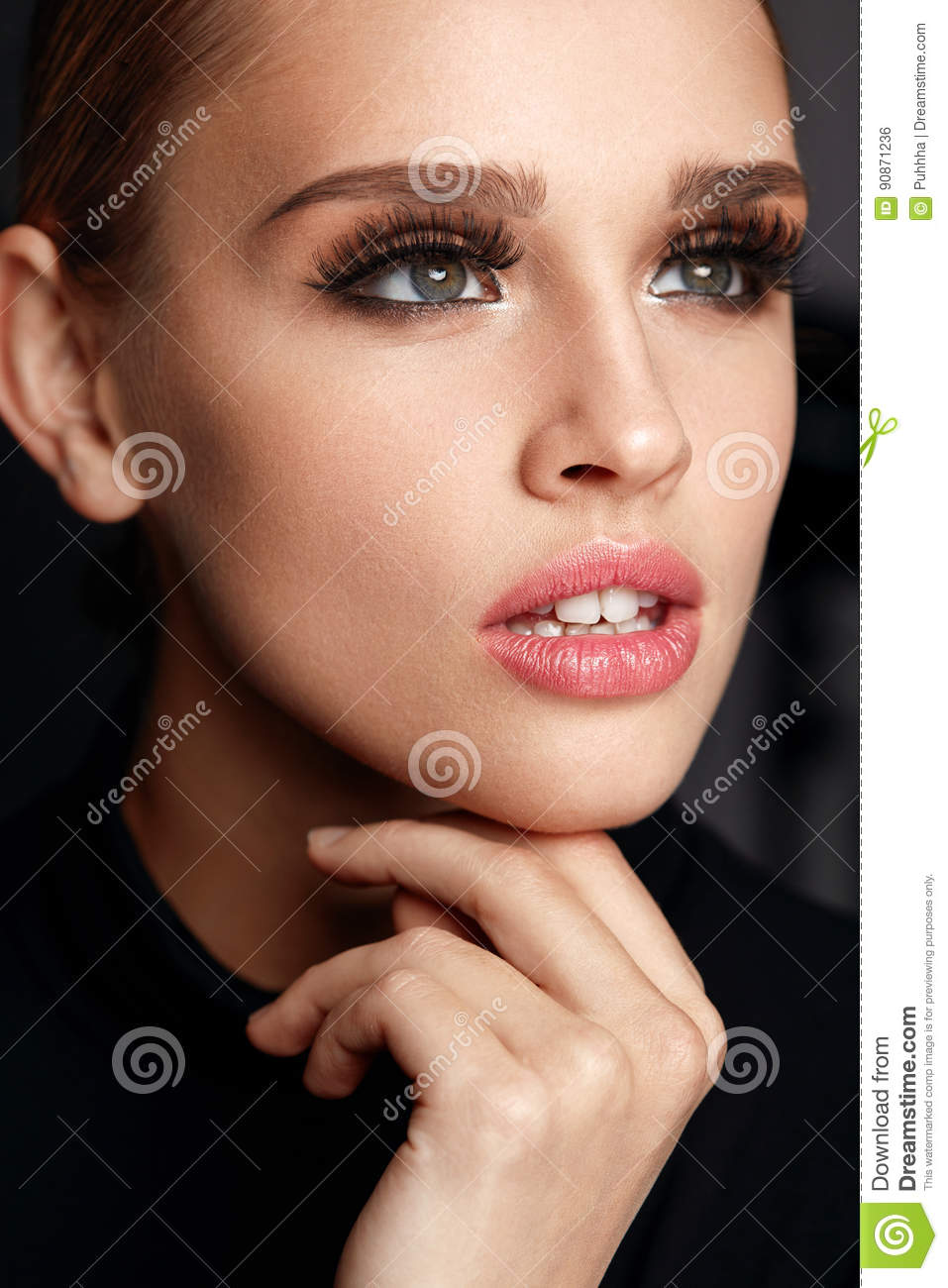 cbbdf5e3579 Beauty Woman Face. Portrait Of Beautiful Young Female With Perfect Facial  Makeup, Soft Fresh Healthy Skin And Thick Long Black Eyelashes. Glamorous  Girl On ...