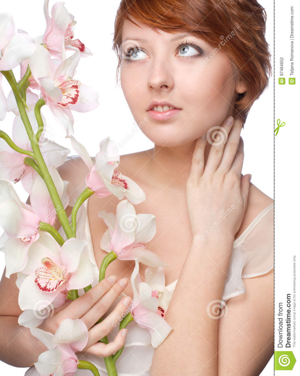 Beautiful girl with big orchid on white
