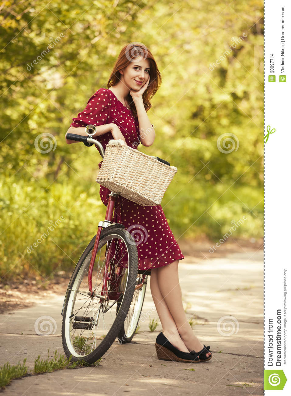Beautiful girl with bike at countryside. Vintage. Photo in old retro ...