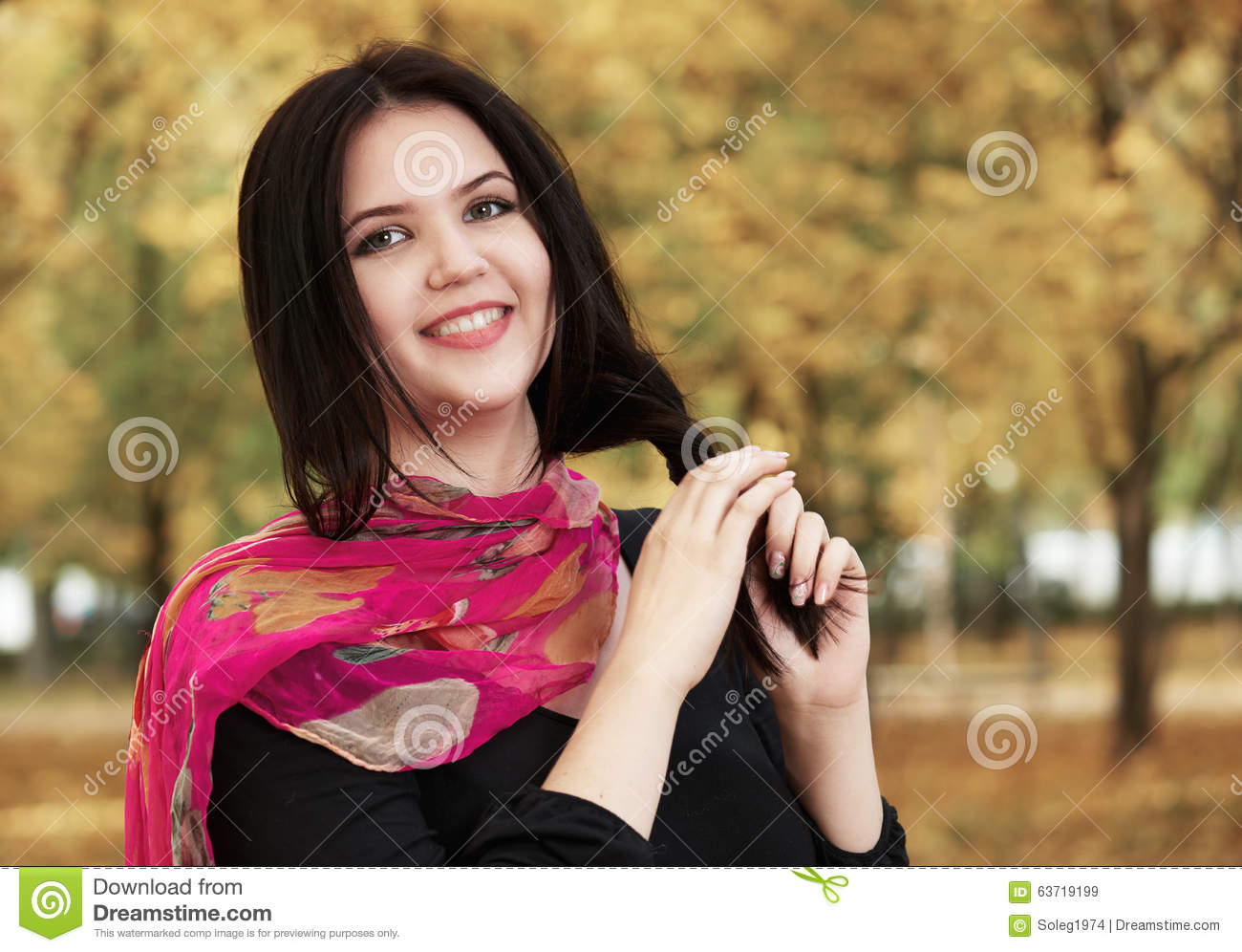 Beautiful Girl In Black Dress And Red Scarf In Yellow City Park