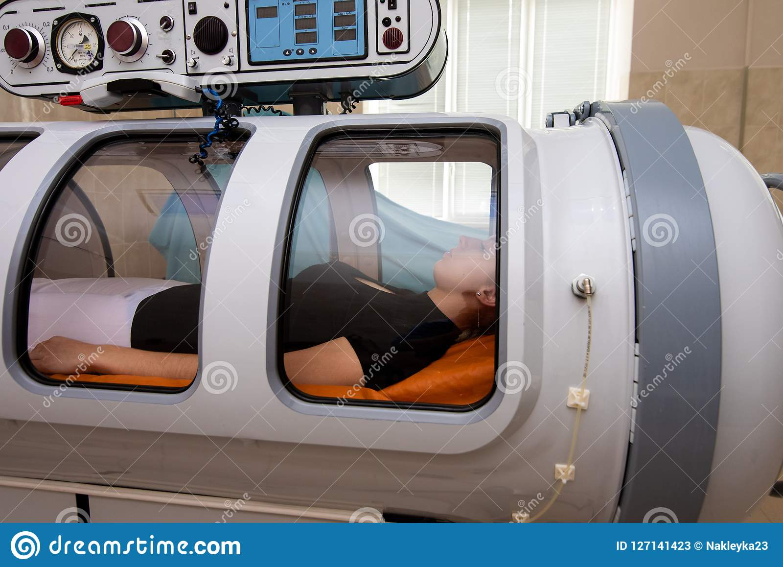 A girl in the hyperbaric chamber