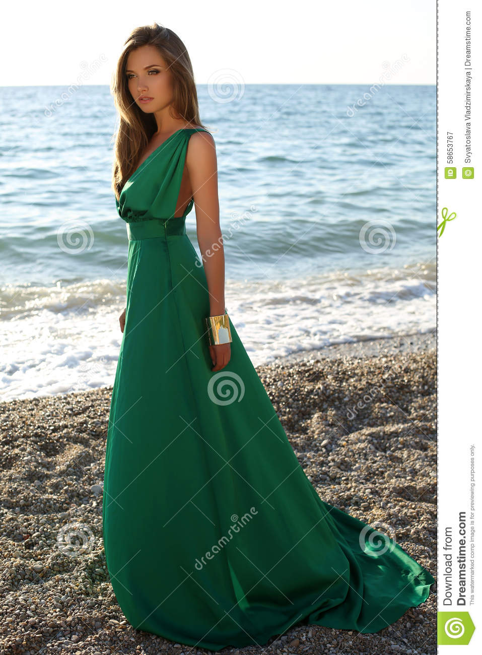 Accessory For Hair: Beautiful Girl With Blond Hair Wears Luxurious Green Dress