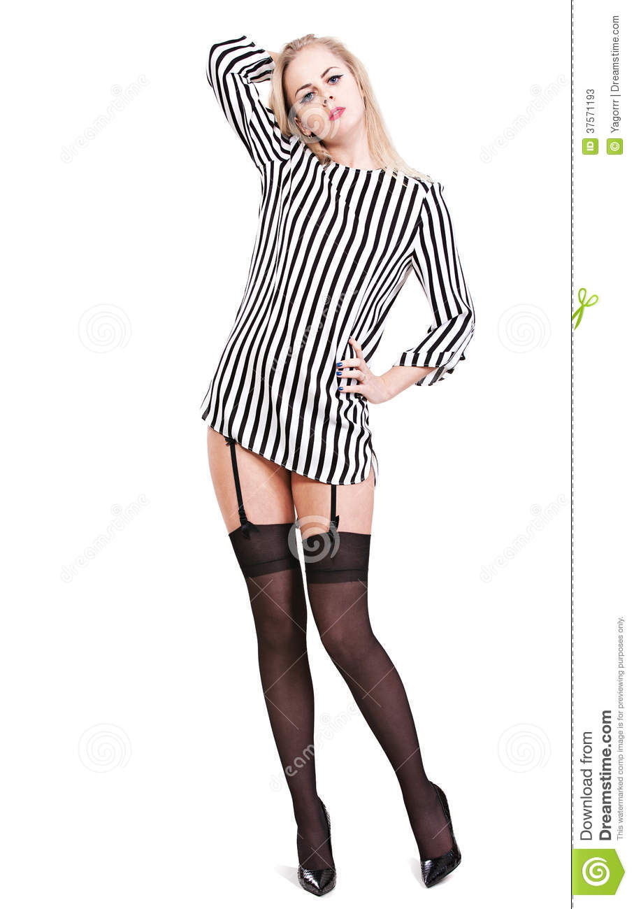 ac54f0b992e31 Young girl in a striped blouse and black stockings on an isolated white  background in full length