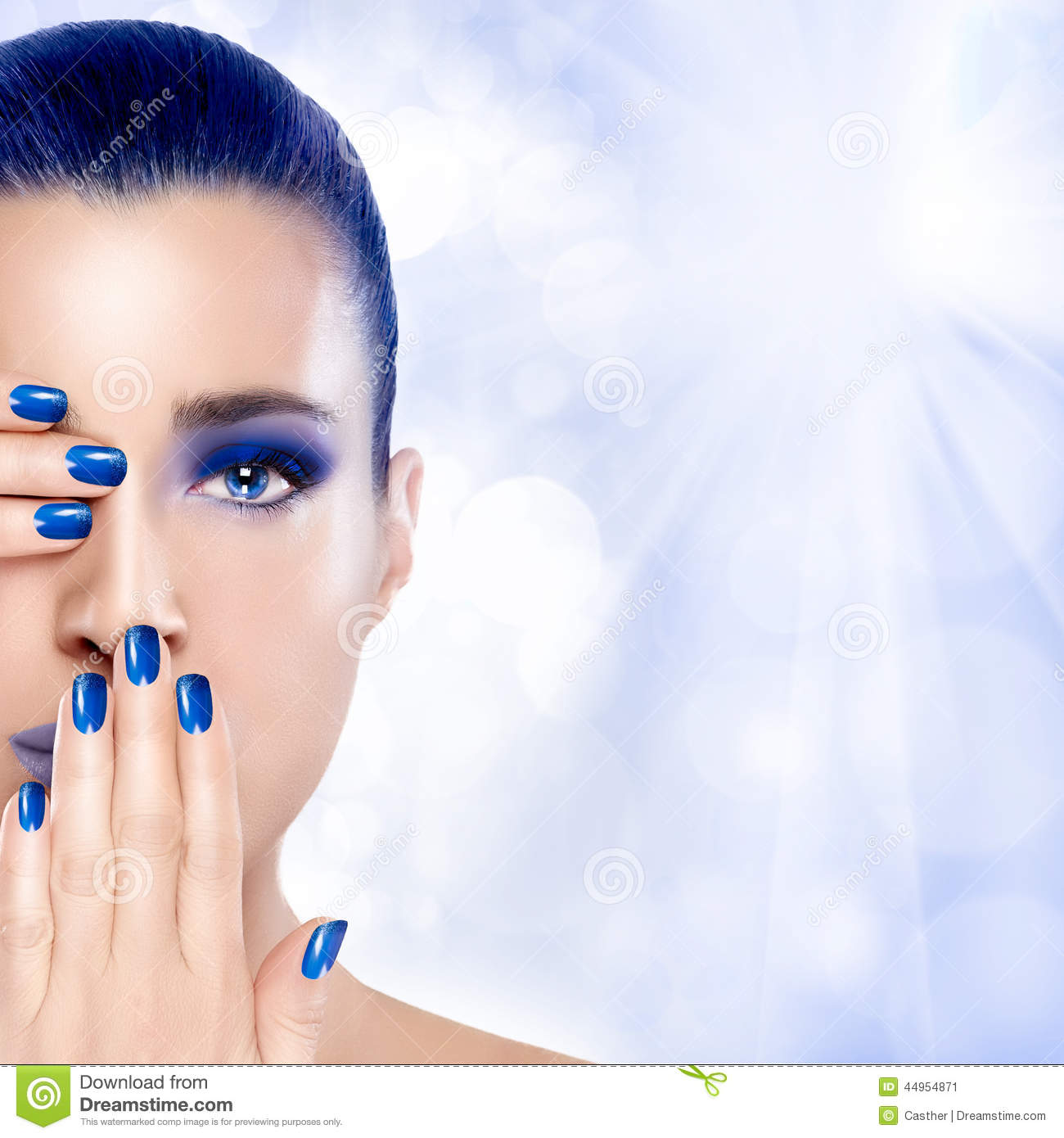 Beautiful Girl In Blue With Hands On Her Face Nail Art And Make