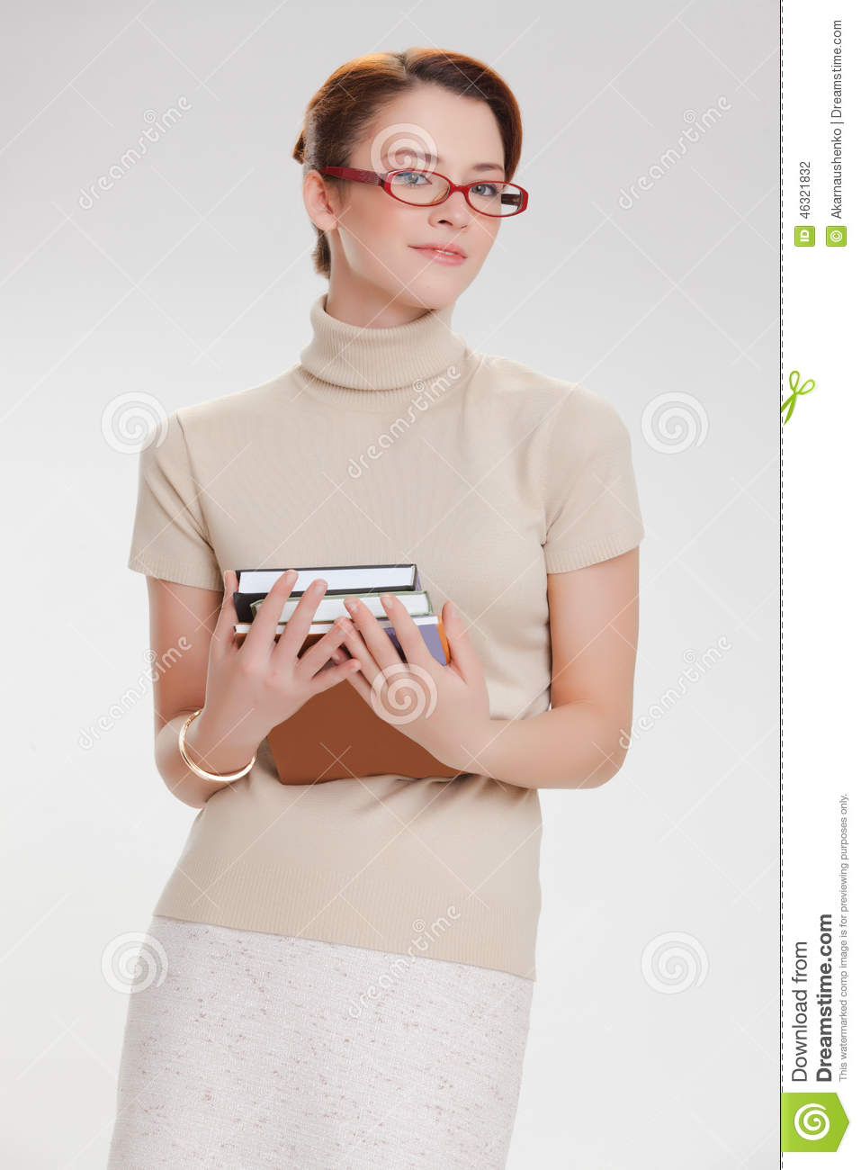 Beautiful Girl With Books And Wearing Glasses Stock Photo