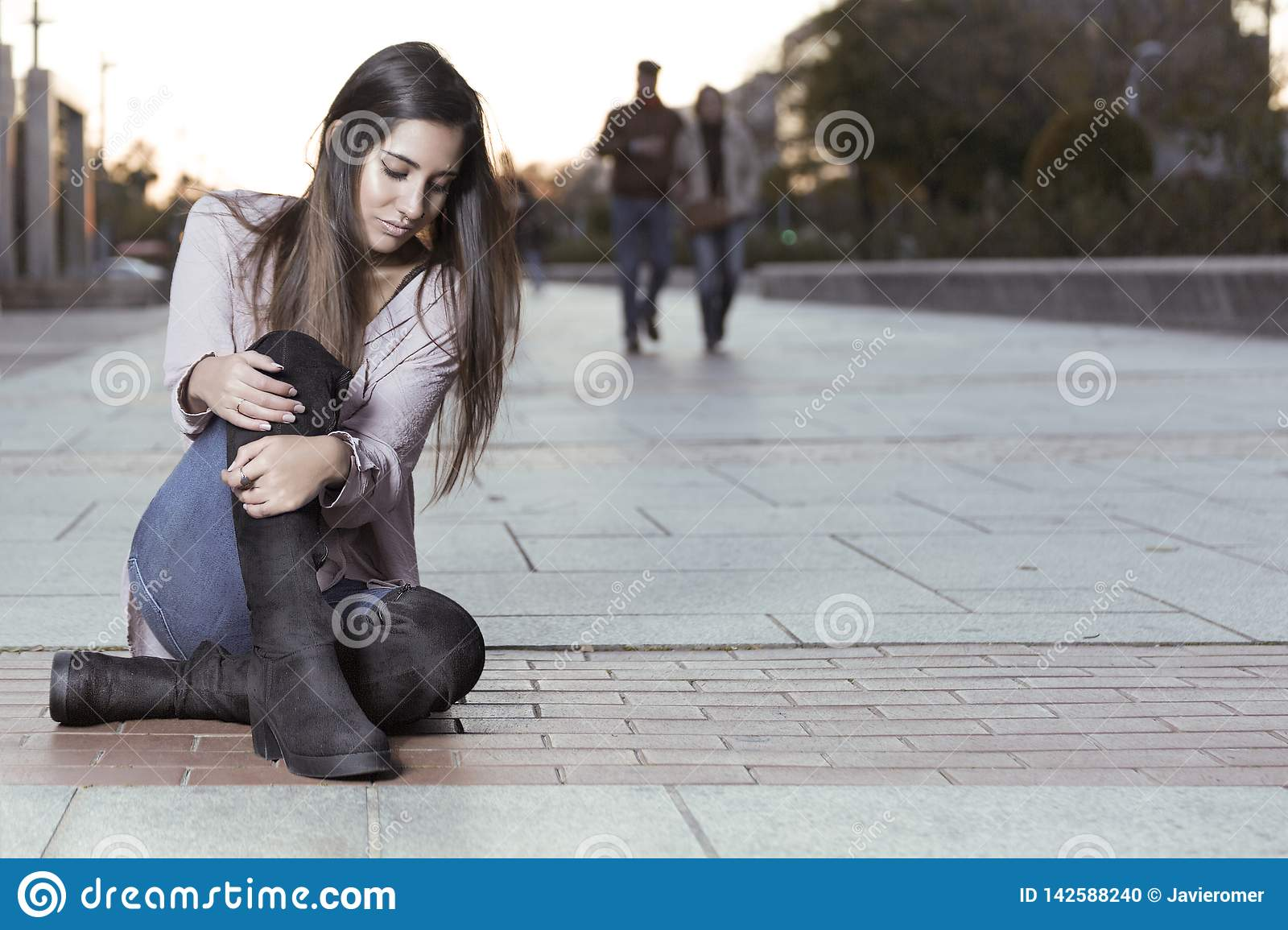 Beautiful girl in boots sitting on the floor