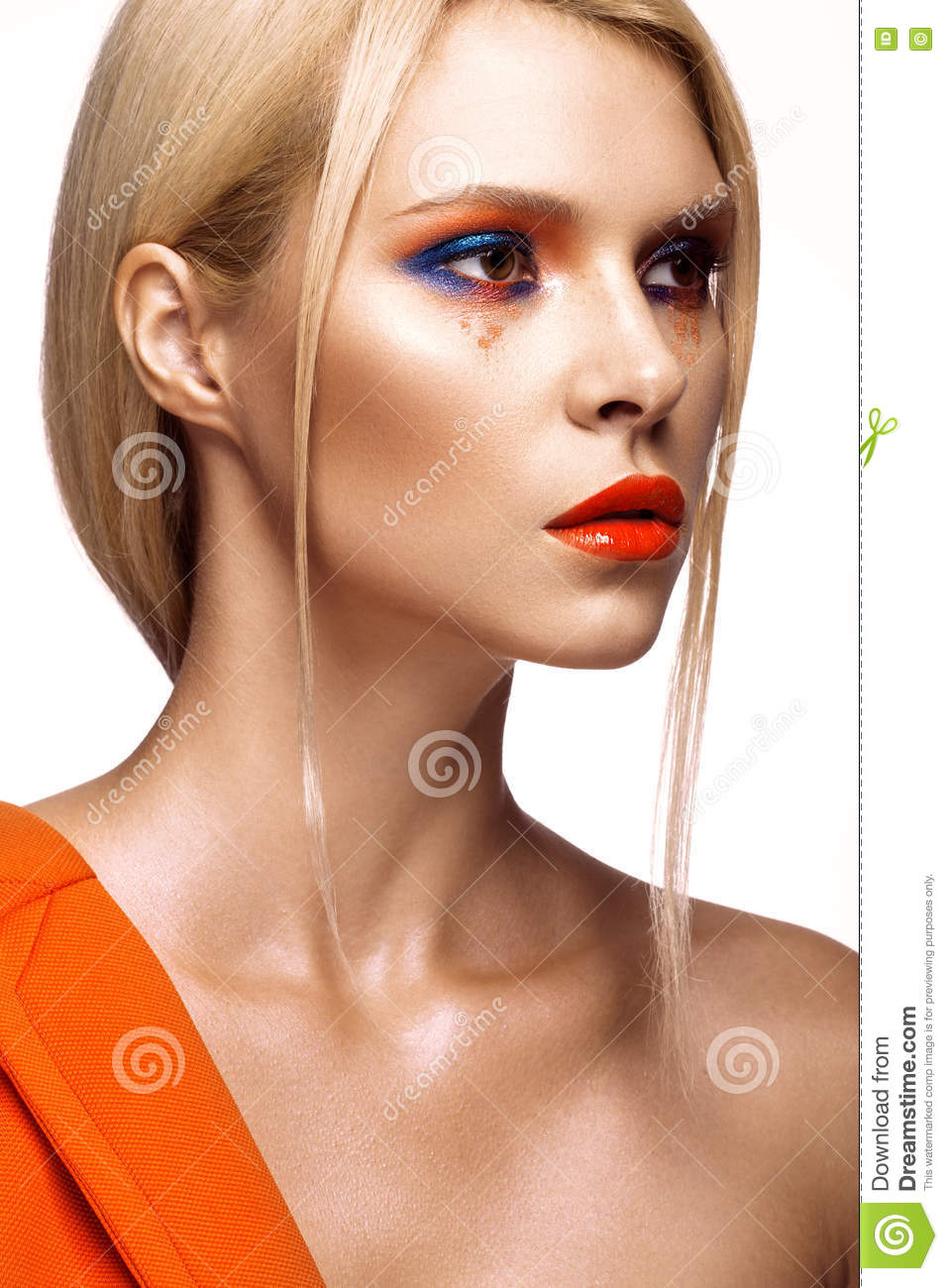 Beautiful girl with bright colored makeup and orange lips. Beauty face.