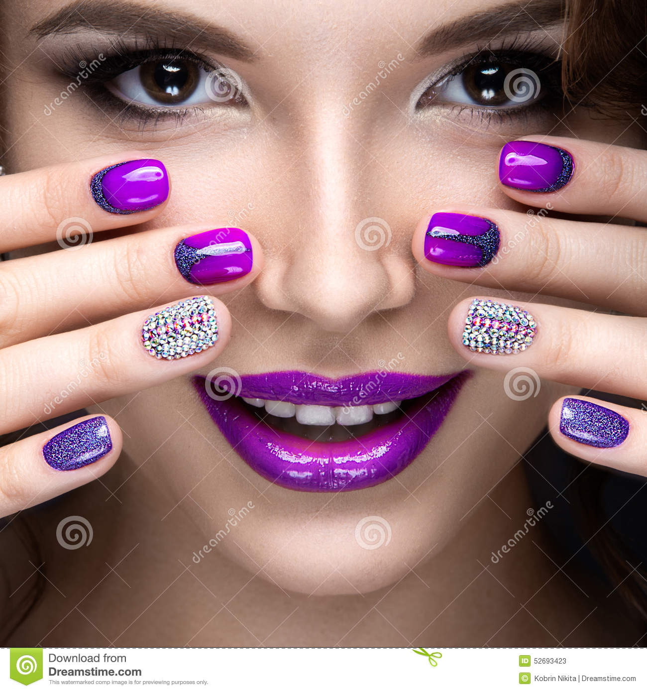 beautiful girl with a bright evening make up and purple manicure with rhinestones nail design. Black Bedroom Furniture Sets. Home Design Ideas