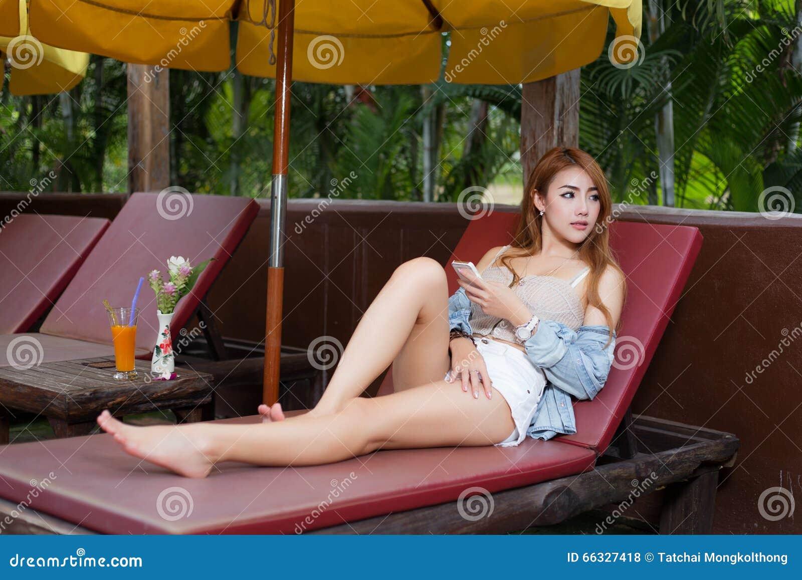 Beautiful girl browsing internet in a smartphone