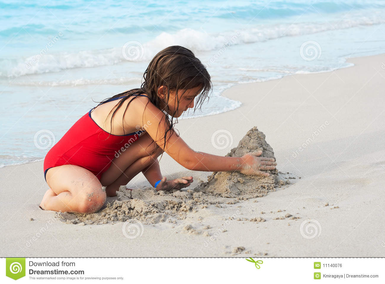 Beautiful Girl Building A Sand Castle In The Beach Royalty ...