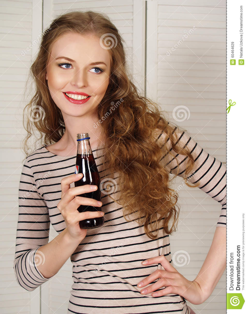 Beautiful girl with carbonated water