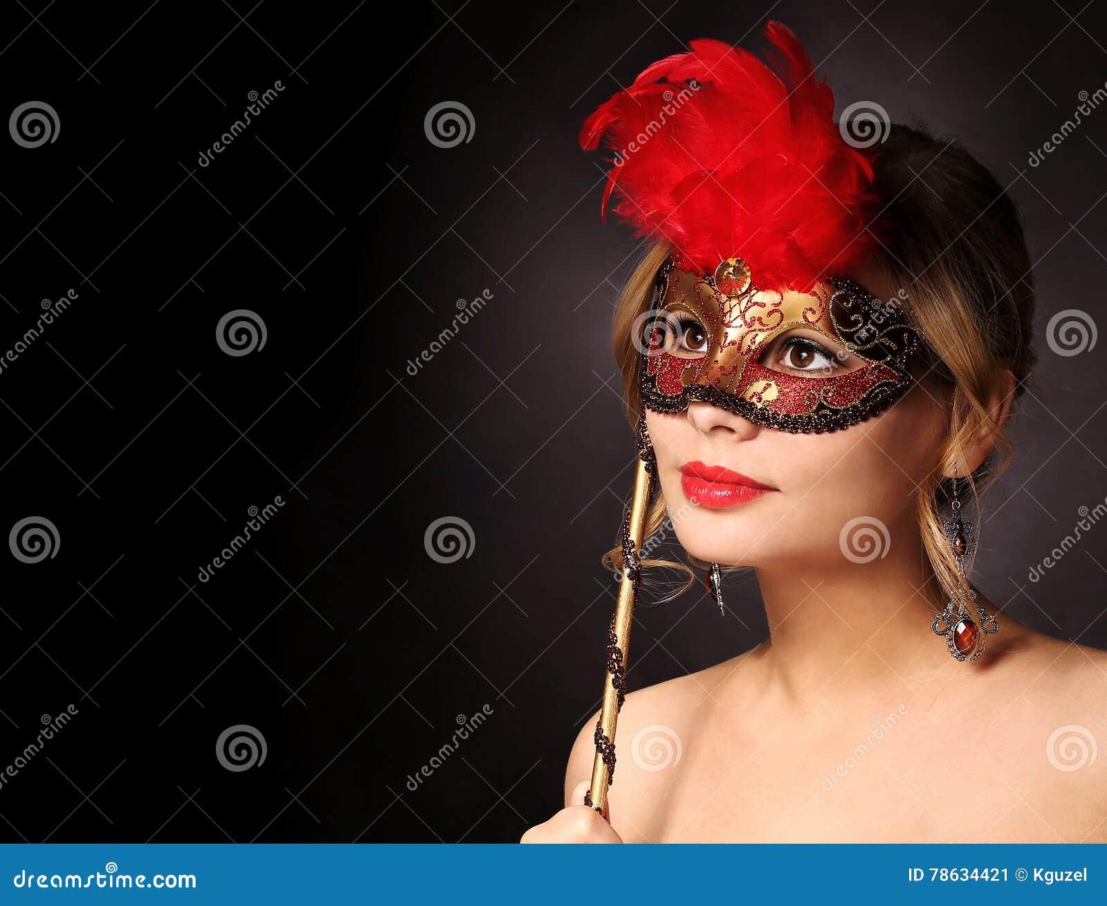 Beautiful girl with carnival mask. Halloween