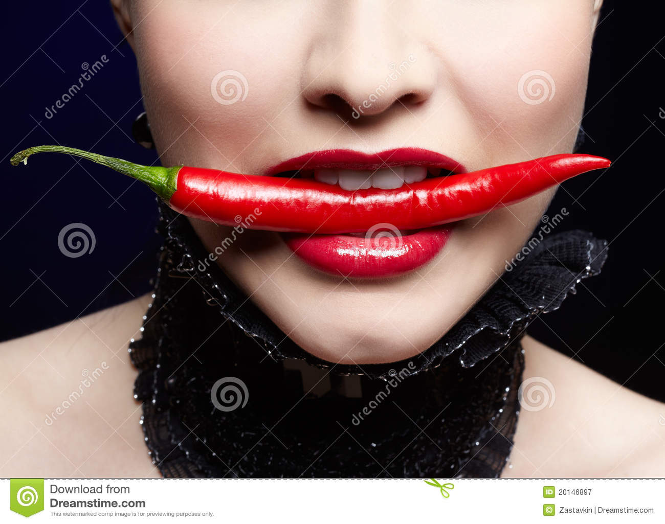 Beautiful girl with chili pepper