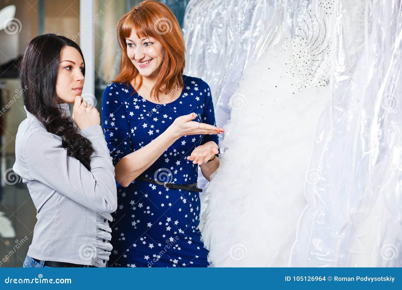 Beautiful girl chooses her wedding dress. Portrait in Bridal sa