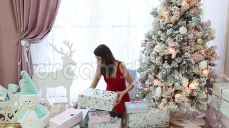 Beautiful Girl With Christmas Gifts In A Smart Room Stock Footage ...