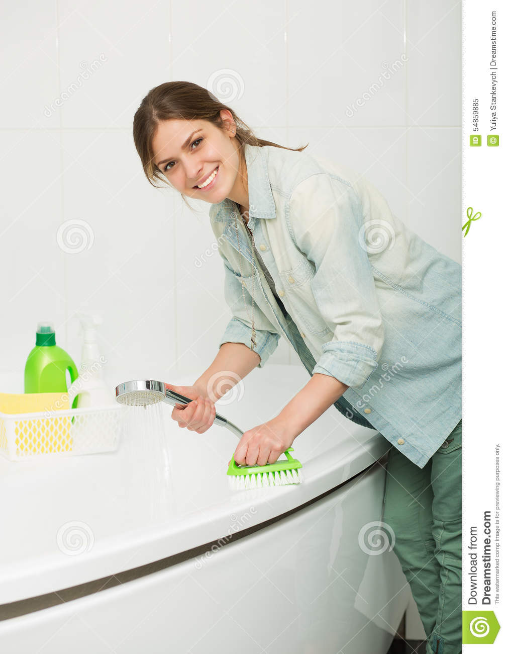 Hardworking young lady cleans the kitchen before pounding 10