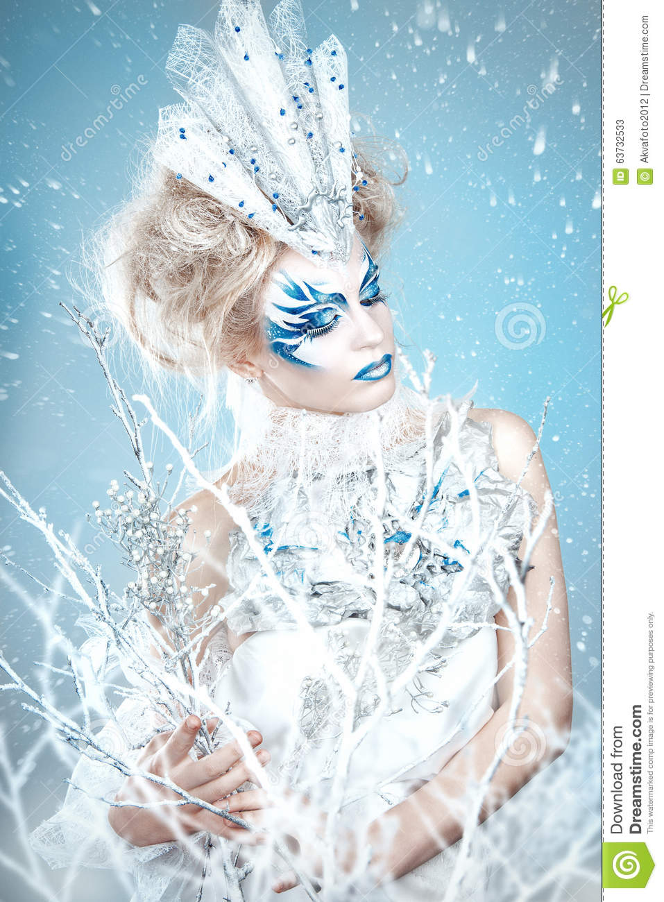 Beautiful girl with creative make-up for the new year. Winter portrait.