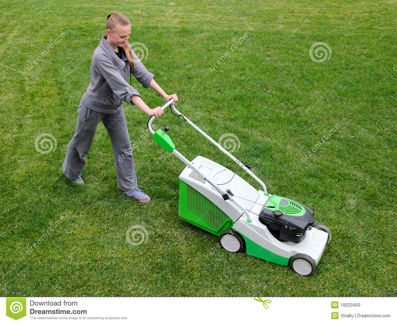 Beautiful Girl Cuts The Lawn Stock Photo - Image: 19223400