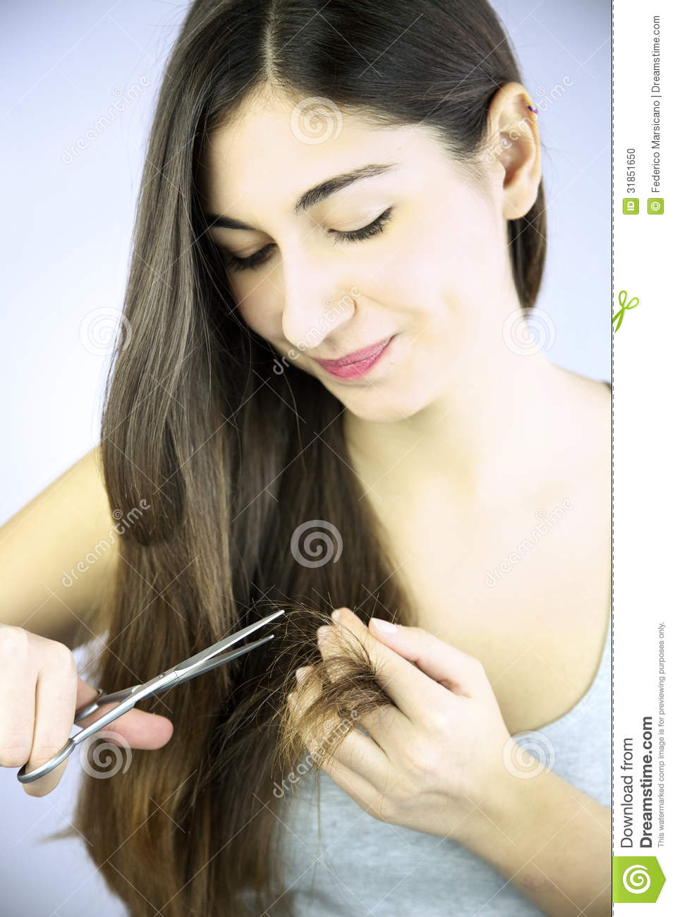 Beautiful Girl Cutting Split Ends Of Long Hair Stock Photo