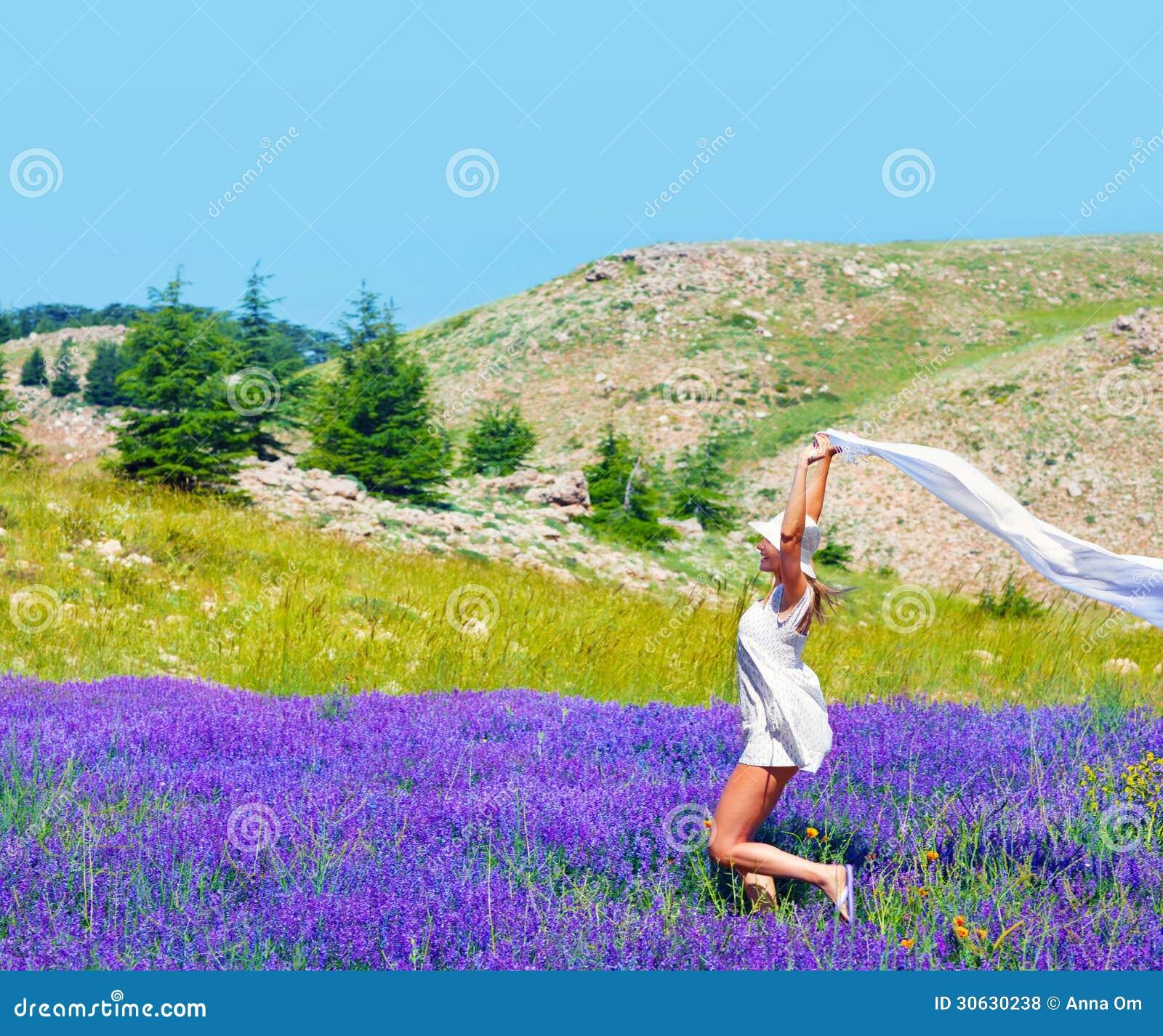 Beautiful Girl Dancing On Lavender Field Stock Photo