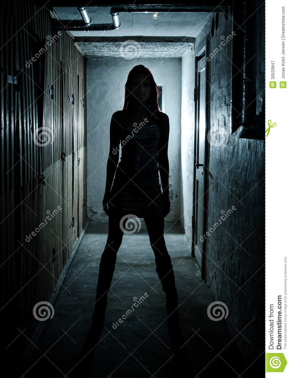 beautiful girl in dark basement royalty free stock photography image