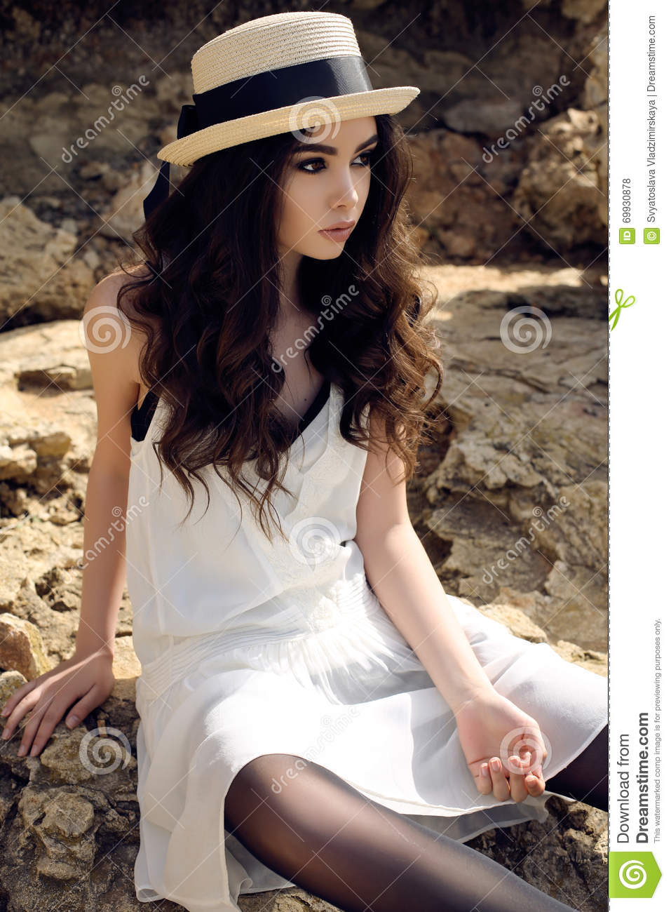 06f9dd649cc Fashion outdoor photo of beautiful girl with dark hair wears casual elegant  clothes and hat posing at summer seacoast