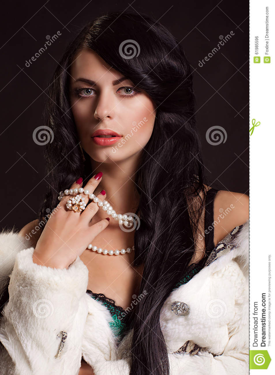 Beautiful Girl With Dark Hair In A White Fur Coat Stock Photo