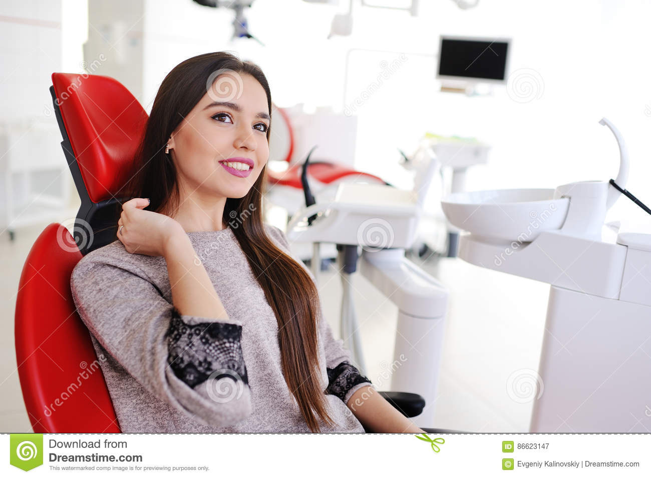 Beautiful girl in the dentist`s chair