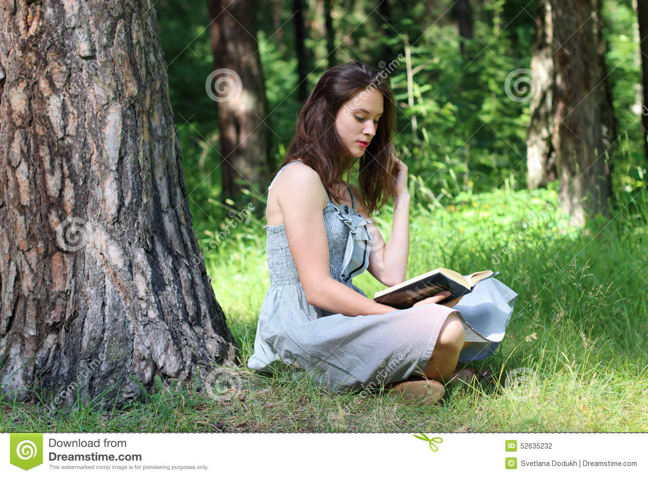 A Little Girl Sitting Under Tree In Autu Stock Image - Image: 22003311
