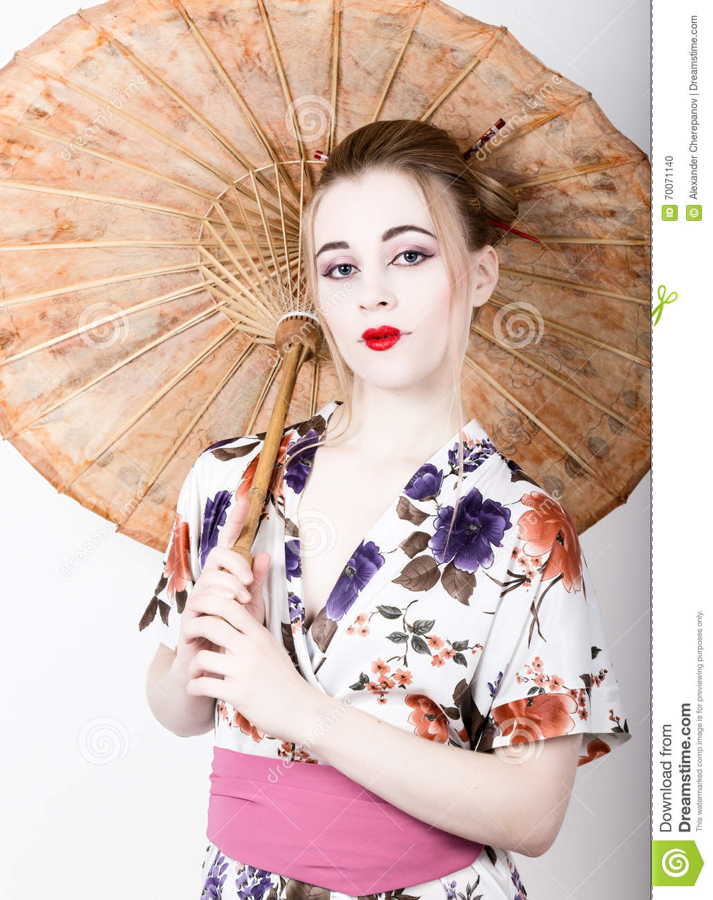 Beautiful Girl Dressed As A Geisha Girl Holding A Chinese