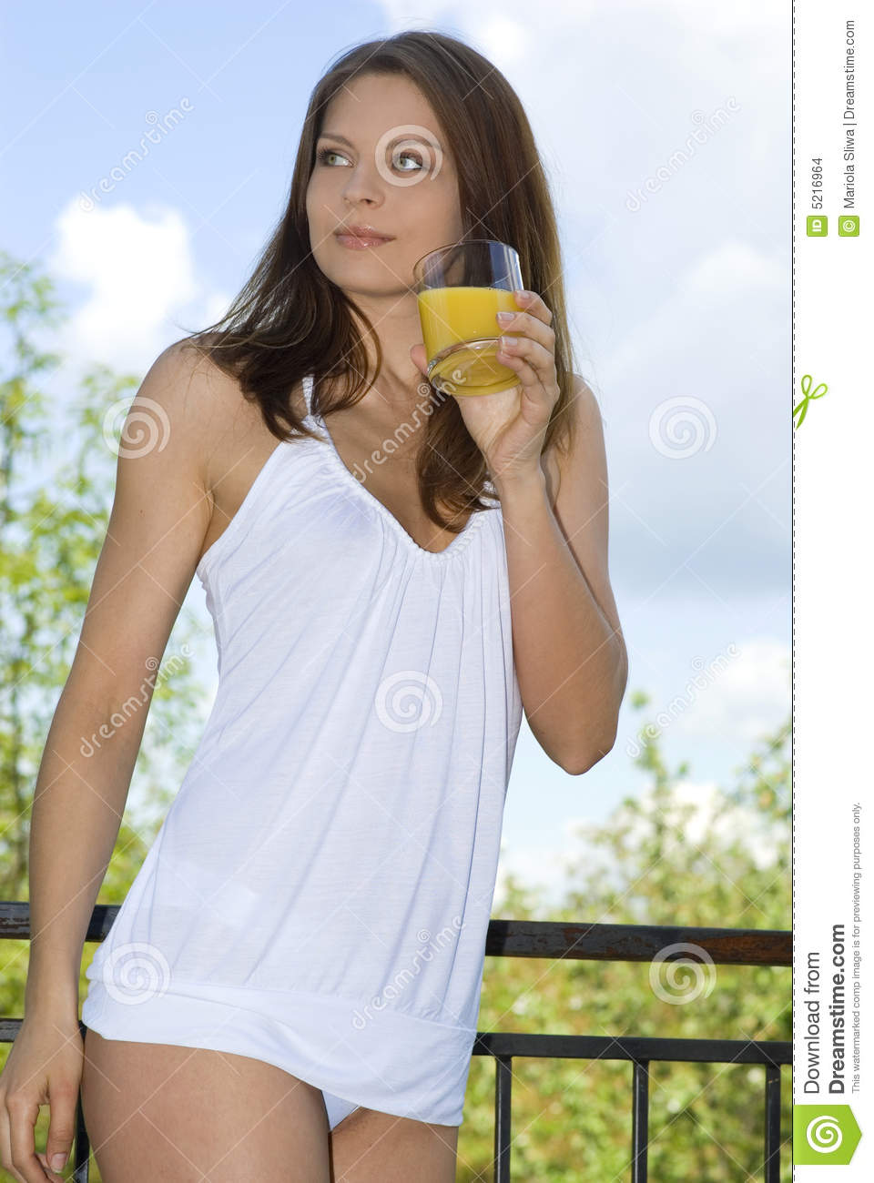 Beautiful girl drinking morning orange on balcony stock for Balcony models