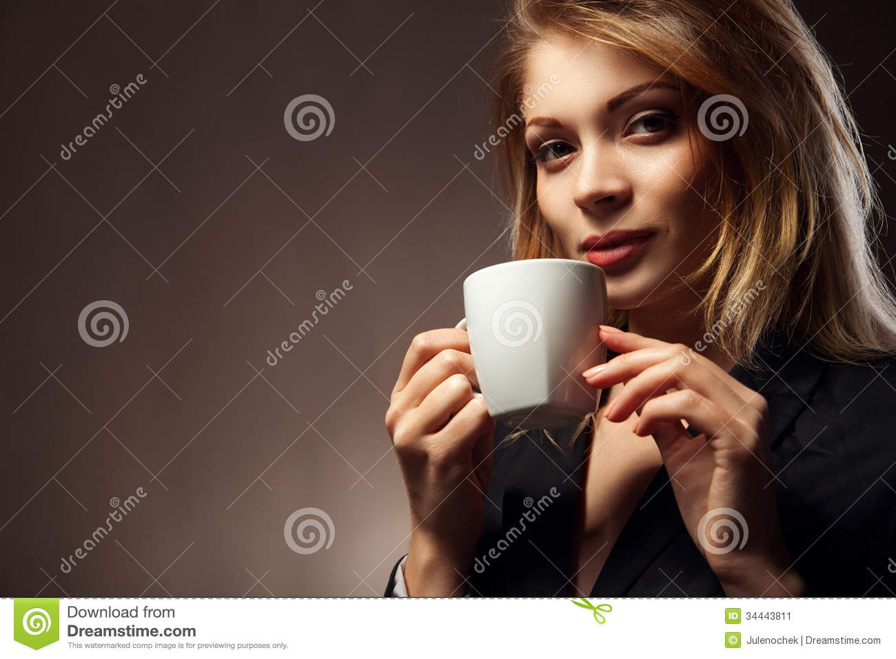Beautiful Girl Drinking Tea or Coffee