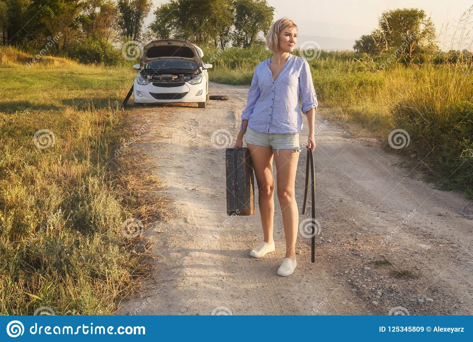 the beautiful girl driver in the car ran out of fuel and she walks along a rural road with an empty fuel tank stock image image of station girl 125345809 https www dreamstime com beautiful girl driver car ran out fuel walks along rural road empty tank rays sunset toned image125345809