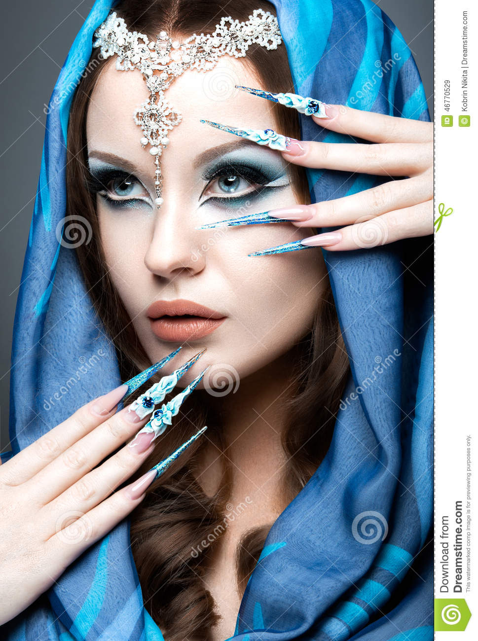 beautiful girl in eastern arabic image with long nails and bright