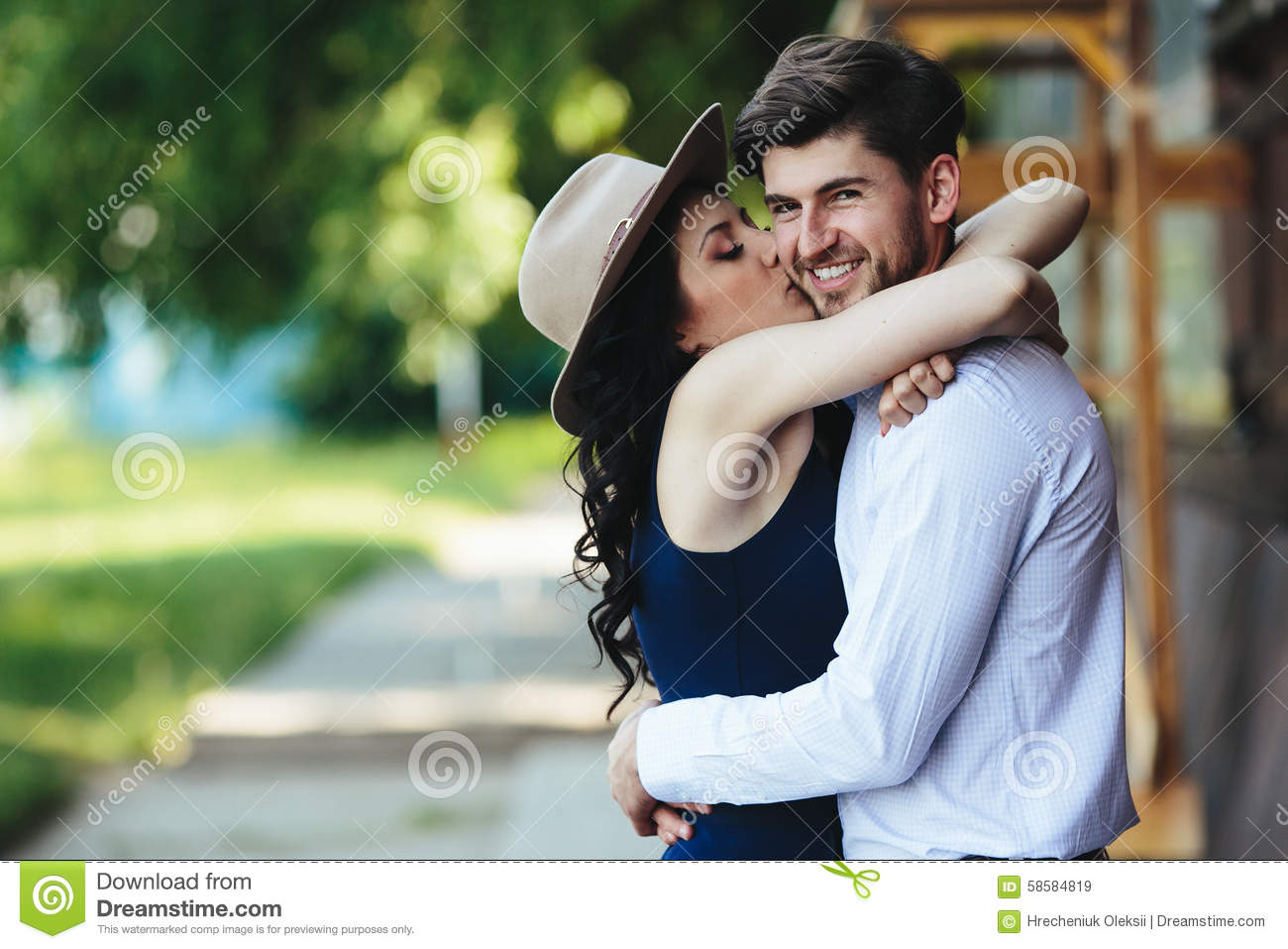 Beautiful Girl Embraces And Kisses Her Boyfriend Stock