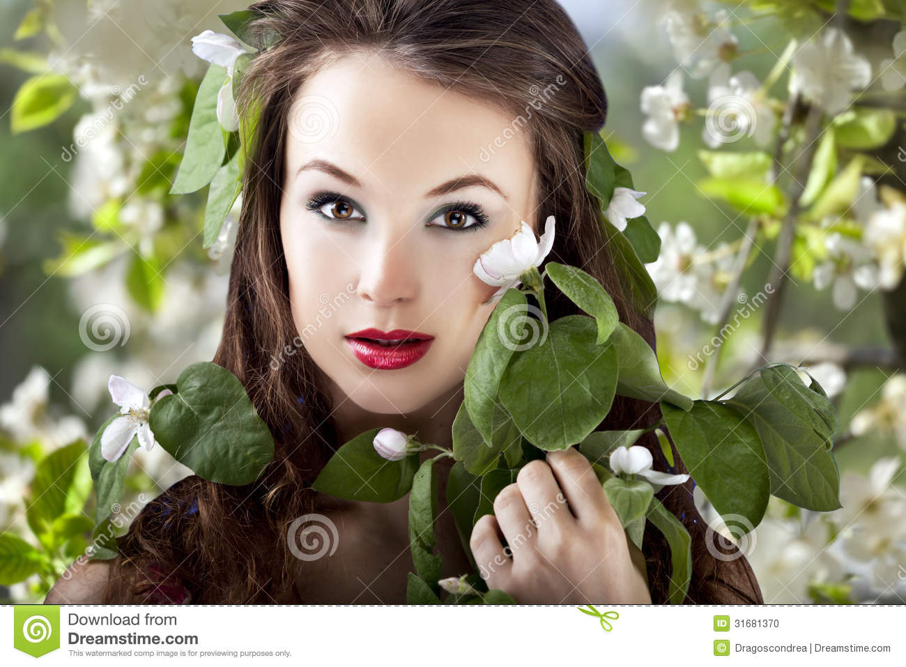 Beautiful Girl On Flower Background With Flowers In Hair