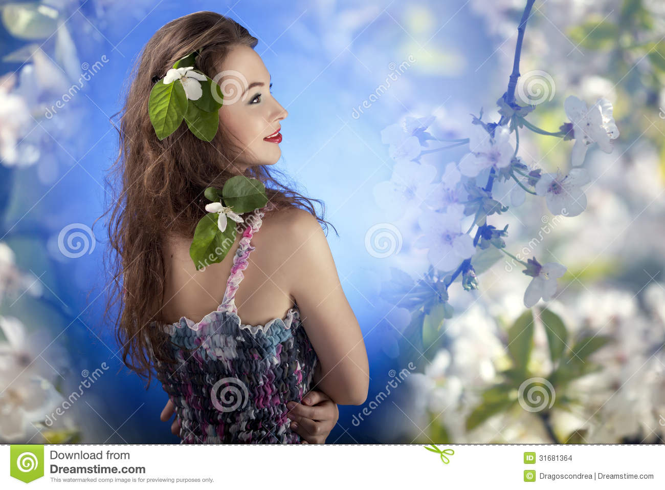 Beautiful Girl With Flowers In Hair On Flower Background Stock Photo