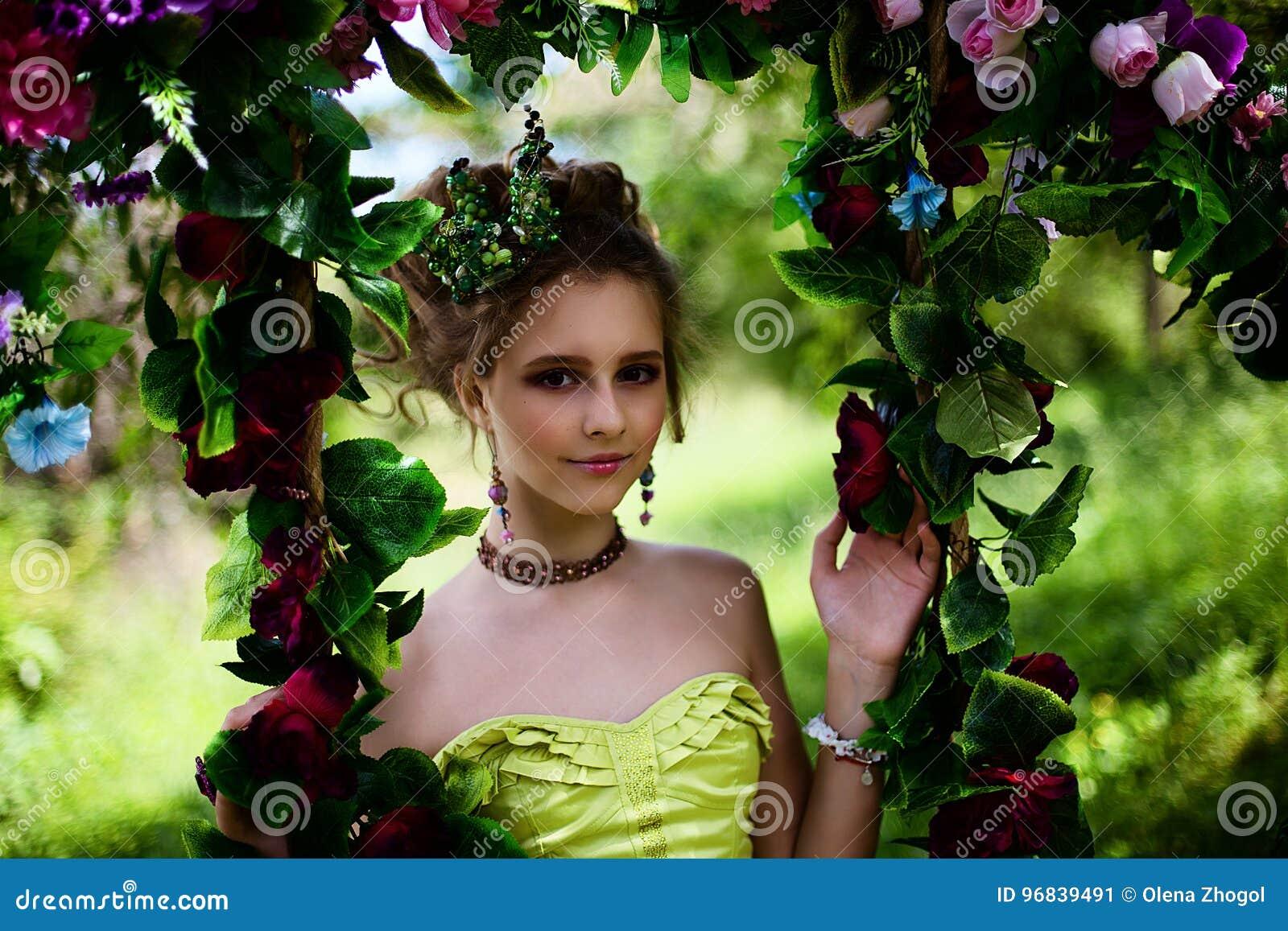 Beautiful girl in the garden with flowers in princess dress stock download beautiful girl in the garden with flowers in princess dress stock image image of izmirmasajfo