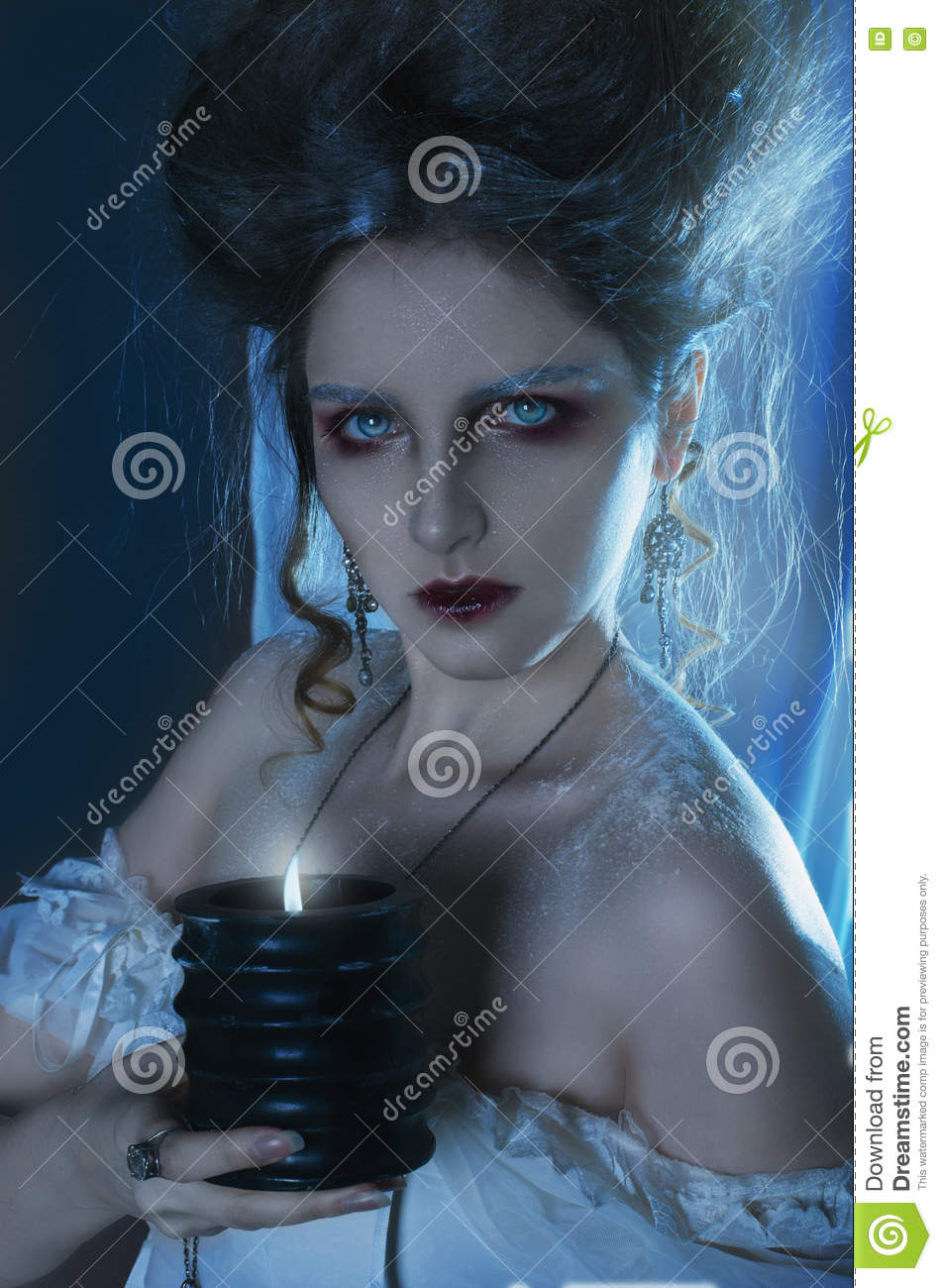 Beautiful girl ghost, witch, dead bride in a white dress with vi