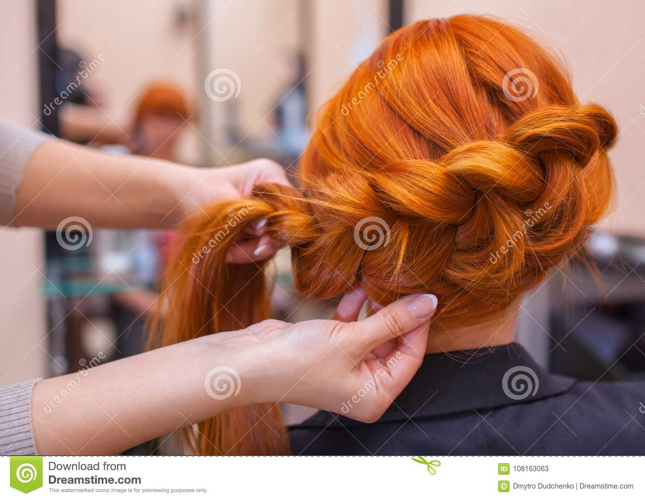 Beautiful Girl Hairdresser Weaves A Braid In A Beauty Salon Stock