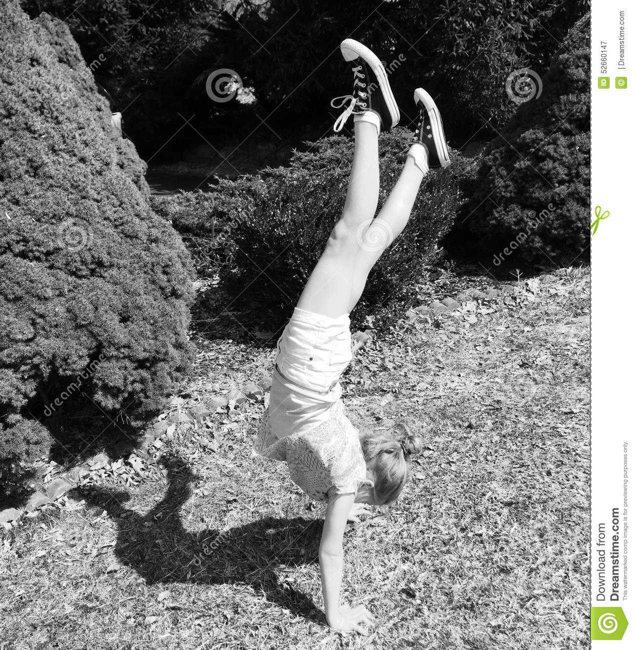 pretty girl doing handstand