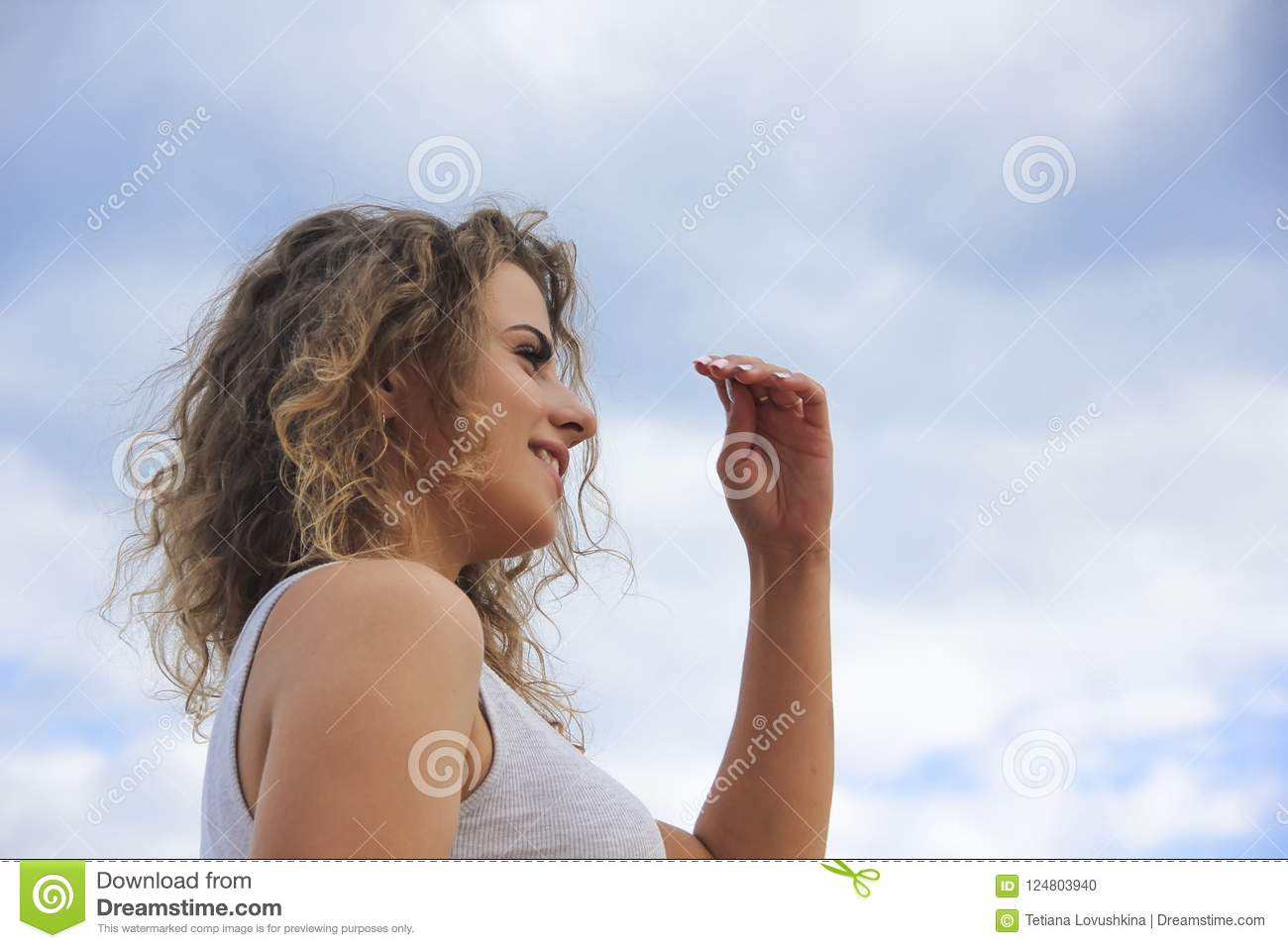 Beautiful girl happy portrait curly hair person expression on the sky background