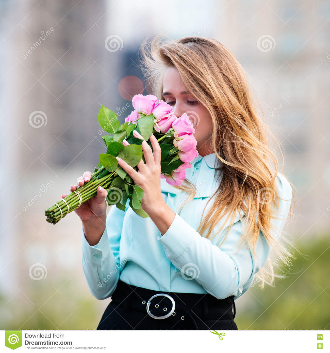 Beautiful girl holding bouquet of pink roses flowers on dating in beautiful girl holding bouquet of pink roses flowers on dating in the city izmirmasajfo Image collections