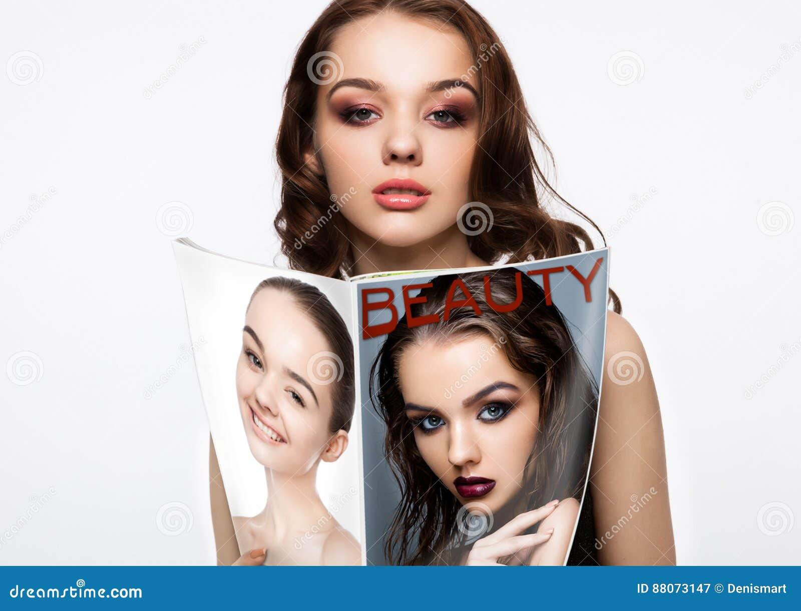 Beautiful Girl Holding Fashion Beauty Magazine Stock Image