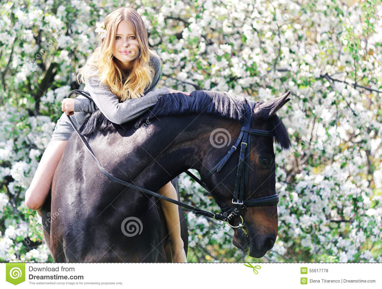 Beautiful girl and horse in spring garden
