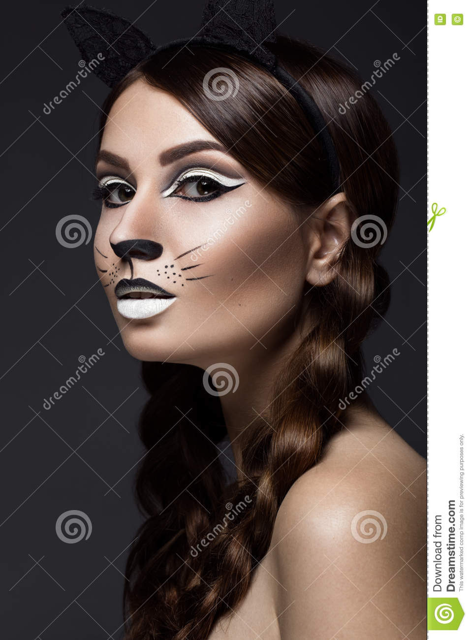 Beautiful girl in the image of a cat with art make-up and lace ears. beauty face. Photos shot in the studio.
