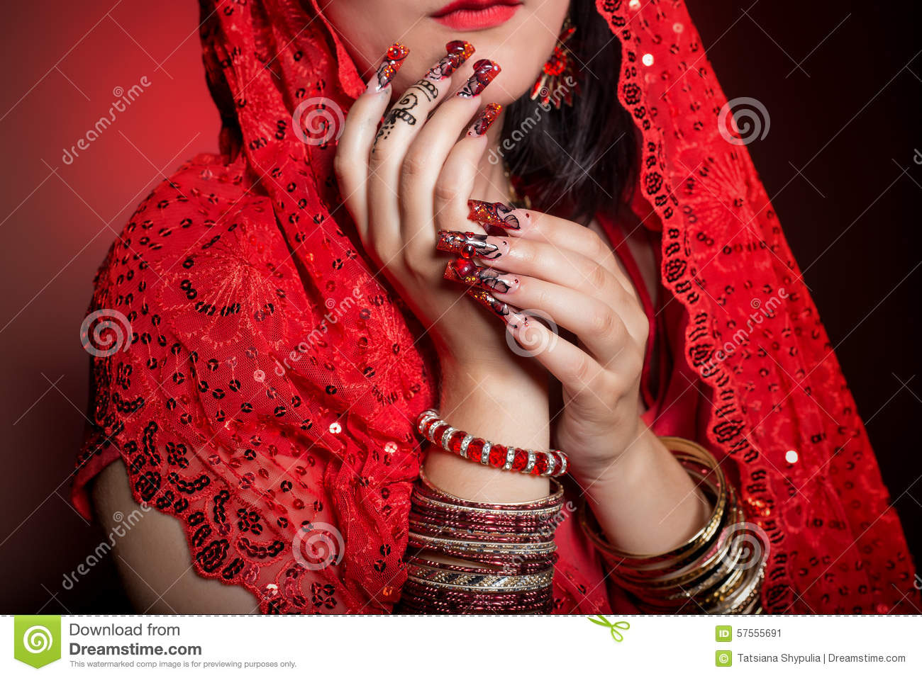 Beautiful Girl In The Image Of Indian Woman In A Red Sari With